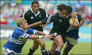 New Zealand's Brad Fleming surges through the Samoan defence
