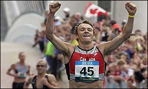 Canada's Simon Whitfield celebrates his country's second gold in the triathlon