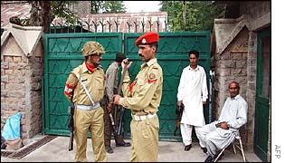 Pakistan army troopers stand guard at the main entrance of the Murree Christian School