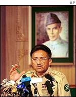 Musharraf under a portrait of Mohamed Ali Jinnah