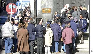 People queue outside a bank in Montevideo