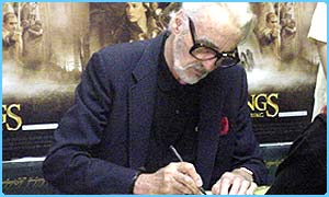 Christopher Lee who plays Saruman signs DVDs