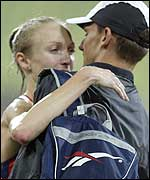 Paula Radcliffe gets a hug from husband Gary Lough
