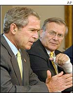 US President George W Bush (left) and US Secretary of Defence Donald Rumsfeld