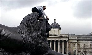 Man doing ironing on statue of a lion