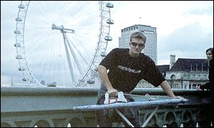 Man ironing in front of London Eye