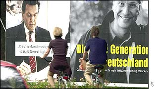 Woman walking past election posters