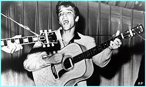 Elvis in 1956 - this photo was used for his first album cover