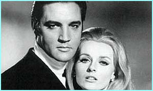 Elvis and Celeste Yarnall, to whom he sang A Little Less Conversation in a film in 1968