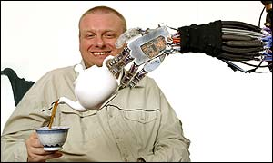 Mark Worsdall, a programmer at Shadow and a spinal muscular atrophy sufferer, being poured a cup of tea by the Shadow Robotic Arm