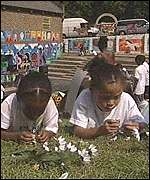 children making daisy chains