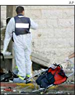 An Israeli forensic expert at the site of a suicide bombing in Jerusalem on 19 June.