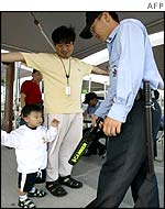 A father and son being checked in South Korea