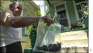 Man shows dead bird at his home in Louisiana