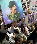 Crowd celebrating Saddam Hussein's birthday
