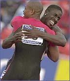 Maurice Greene and Dwain Chambers hug after a race