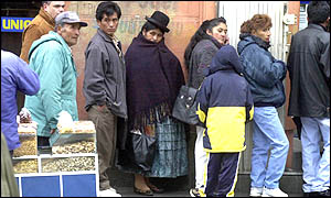 Bolivian savers queue outside a bank