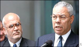 Chief Palestinian negotiator Saeb Erekat with Secretary of State Colin Powell