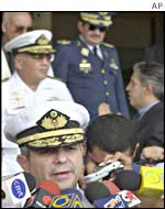 One of the four officers, Vice Adm. Daniel Comisso, speaks to the press