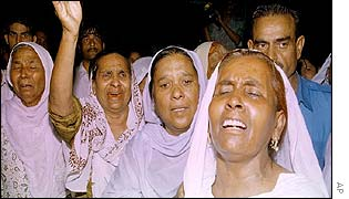 Relatives of grenade victim outside hospital in Taxila