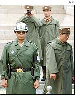 North Korean soldiers photograph South Korean guards