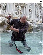 Roberto Cercelletta fishing in Trevi fountain