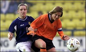Donna James of Scotland (left) tackles Holland's Sarina Wiegman