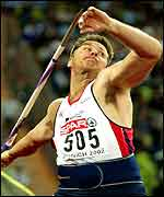 Steve Backley launches his javelin in the Munich final