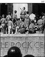 Soldiers accompany nine black students to school in Little Rock, Arkansas