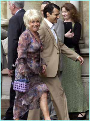 Barbara Windsor, also known as landlady Peggy, showed a bit of leg before entering the Cathedral!