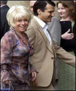 Barbara Windsor and her husband Scott Mitchell arrive for the wedding