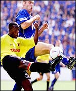 Watford's Neil Cox is tackled by Jamie Scowcroft.