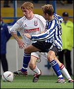 Bjarni Gudjonsson (left) goes past Sheffield Wednesday's Simon Donnelly.
