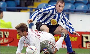 Bjarni Gudjonsson loses out to Sheffield Wednesday's Alan Quinn.