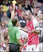 Arsenal's Patrick Vieira is booked by Alan Wiley