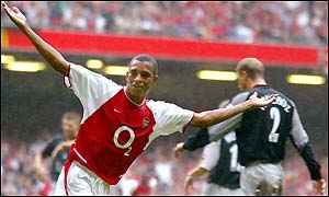 Arsenal's Brazilian matchwinner Gilberto Silva celebrates the only goal of the Community Shield in Cardiff
