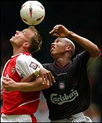 Arsenal's Dennis Bergkamp (left) and El Hadji Diouf of Liverpool
