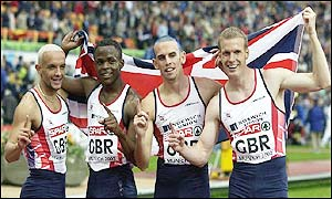 Jamie Baulch, Daniel Caines, Matt Elias and Jared Deacon celebrate winning gold in the 4x400m relay