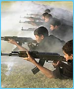 Boys practice firing AK-47 assault rifles