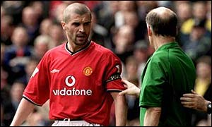 Referee David Elleray calls Keane over after his tackle on Alf-Inge Haaland