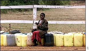 Kenyan child with water containers   AP