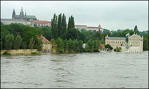 Water floods an art gallery beneath the Hradcany castle