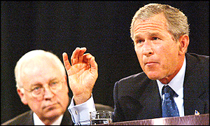 President George W Bush (right) with speaks as Vice-President Dick Cheney