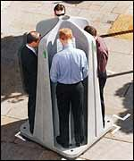 Men in portable urinal, WCC photo