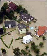An aerial photograph flooded houses in Linz