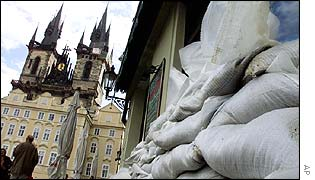 Sand bags stacked up against an old restaurant in the Old Town