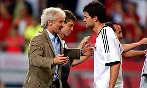 Michael Ballack is congratulated by Germany coach Rudi Voeller