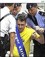 Falun Gong member being arrested