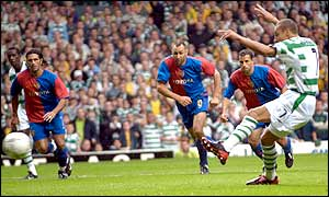Celtic's Henrik Larsson scores a penalty to equalise for the Scottish giants just before half-time