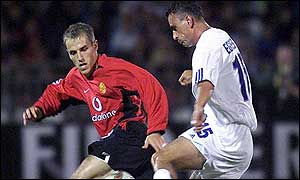 Phil Neville battles for the ball with Gabor Egressy of Zalaegerszeg